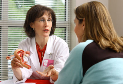 physician and patient talking