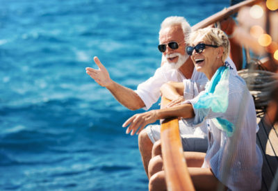 male and female seniors on a boat