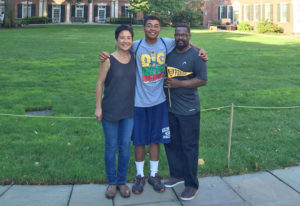parents and son on college campus
