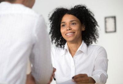 woman in professional attire, smiling
