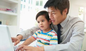 Man at Laptop with Child
