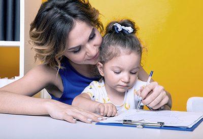 Mother homeschooling child