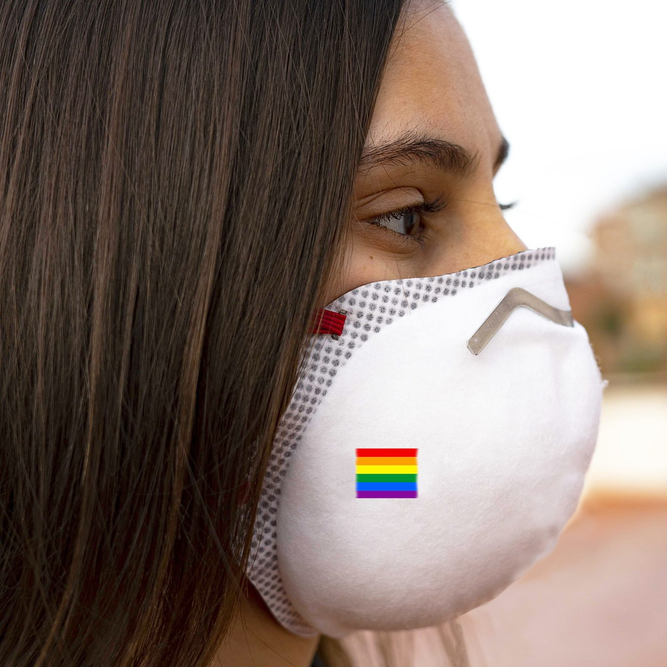 Person wearing PPE mask with pride flag